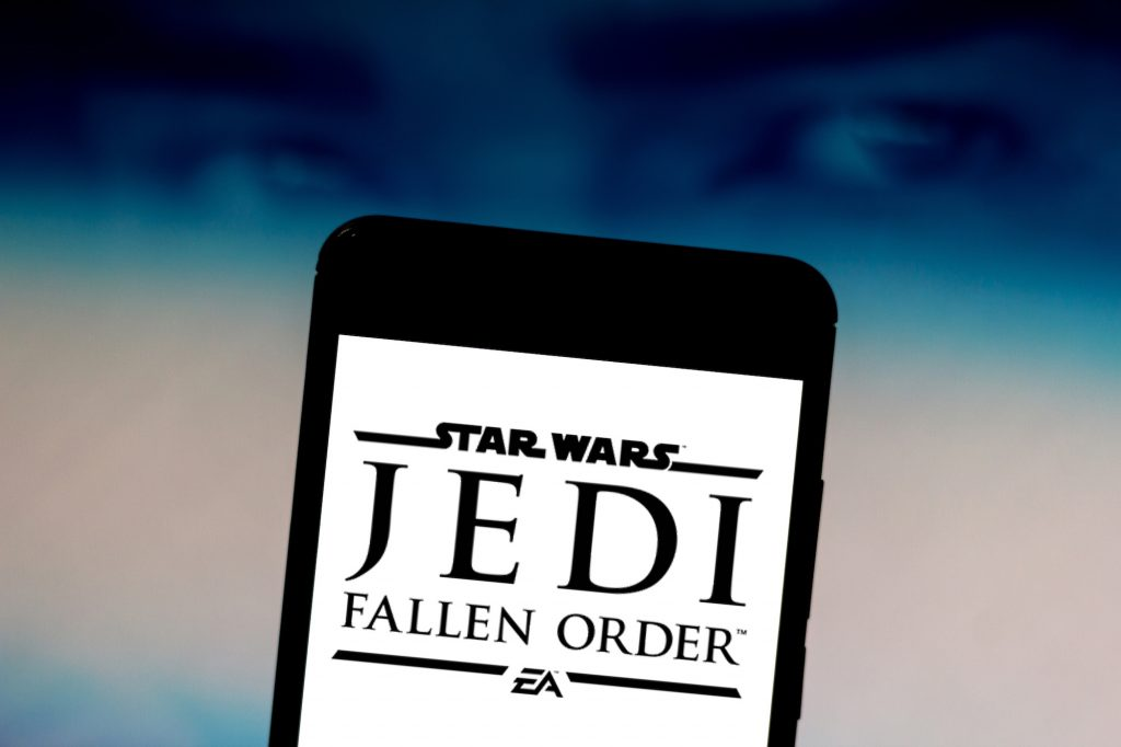 In this photo illustration the Star Wars Jedi: Fallen Order logo is seen displayed on a smartphone