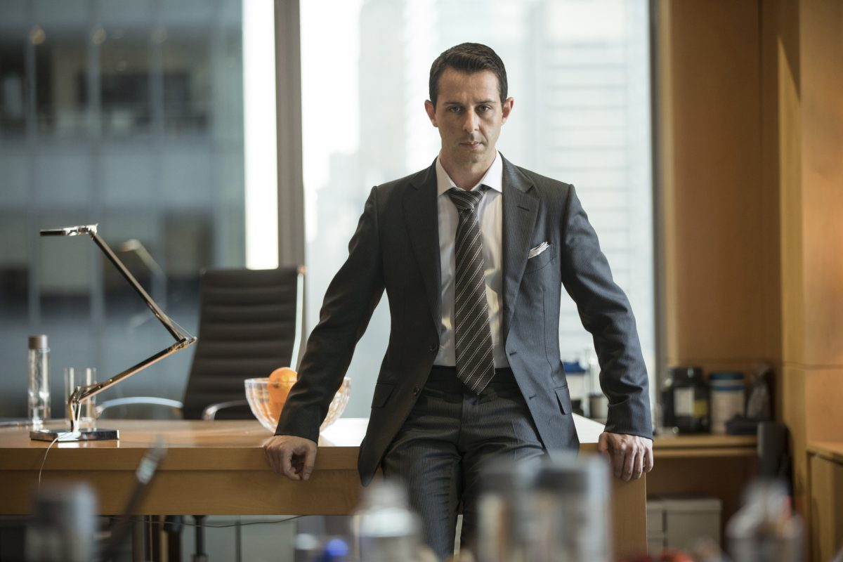 Jeremy Strong as Kendall Roy on 'Succession' standing in front of a desk