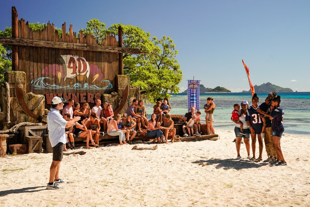 Jeff Probst, the host of 'Survivor' Season 41, on the beach with the players of 'Survivor: Winners at War'