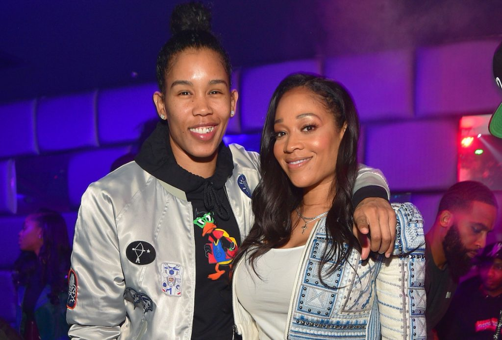 Tamera Young and Mimi Faust hugging as they pose for a photo together at a party in 2018