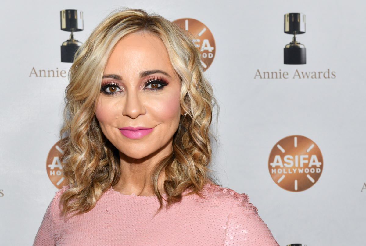 Tara Strong wearing a pink sweater at the Annie Awards