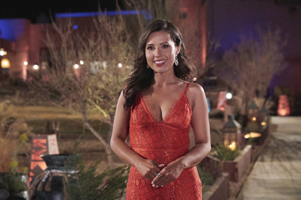 Katie Thurston standsi n a red dress in front of a building on 'The Bachelorette'
