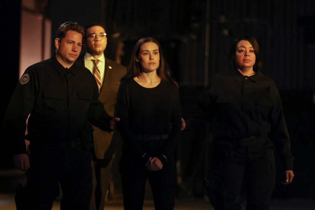 Harry Lennix as Harold Cooper escorts Megan Boone as Liz Keen to the same box Reddington used in the pilot.