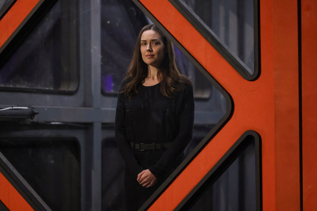 Megan Boone as Liz Keen looks out from the box Reddington was in during the pilot episode.