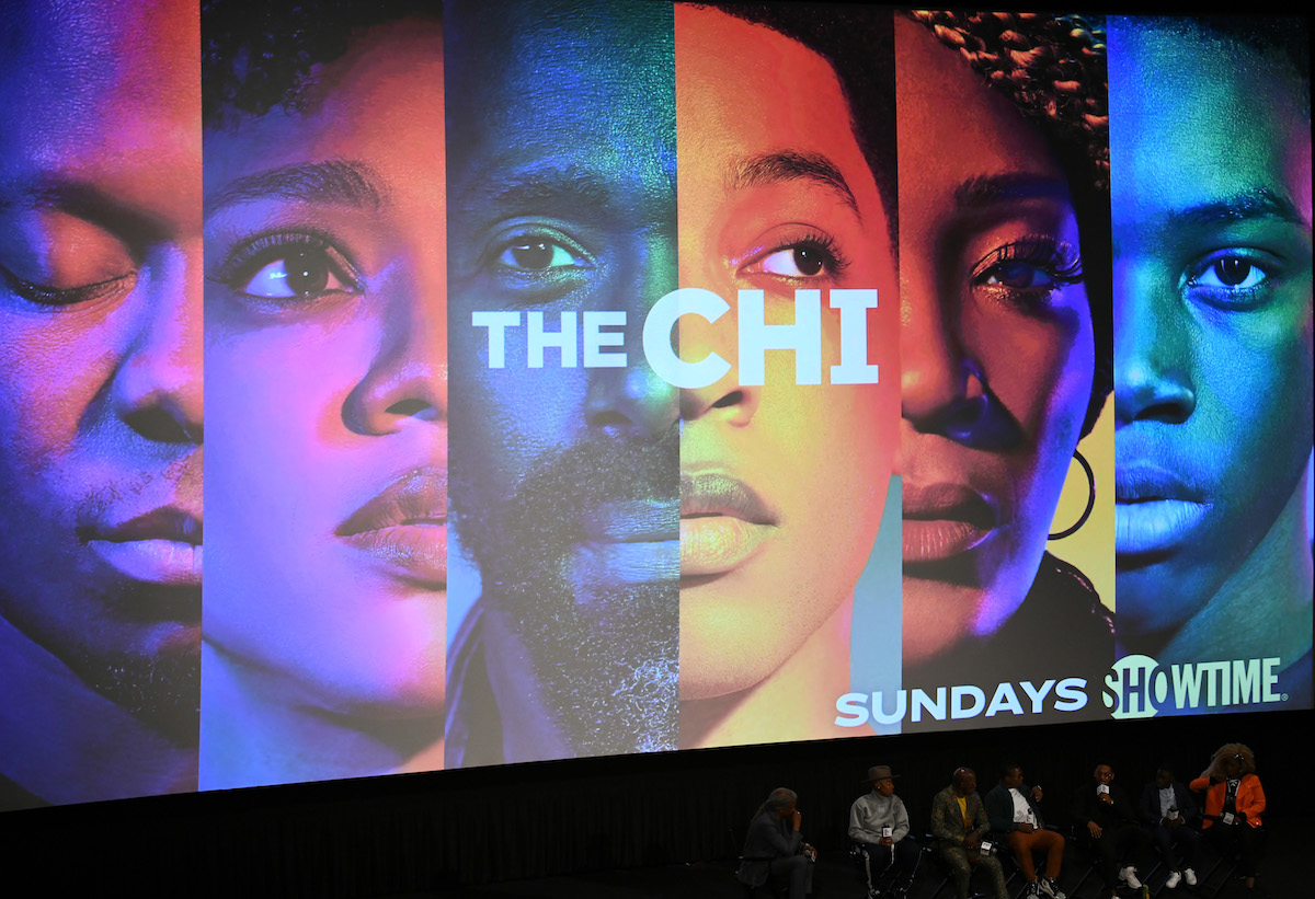 'The Chi' cast appears in front of a screen promoting the show.