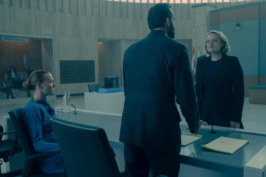 Serena Joy Waterford, Fred Waterford, and June Osborne in a courtroom in season 4 episode 8 of 'The Handmaid's Tale'