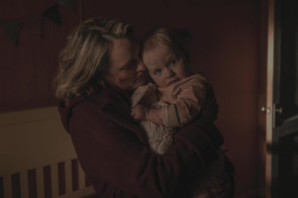 A bloody June Osborne holding her baby at the end of 'The Handmaid's Tale' Season 4