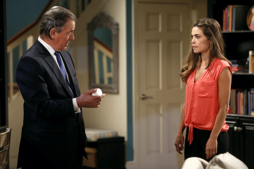 Eric Braeden and Amelia Heinle in a living room on 'The Young and the Restless'