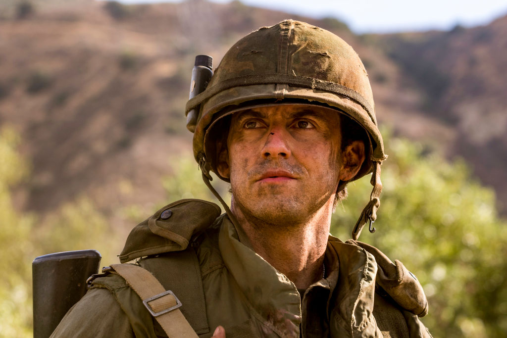 Milo Ventimiglia as Jack Pearson looks concerned, dressed in army gear.