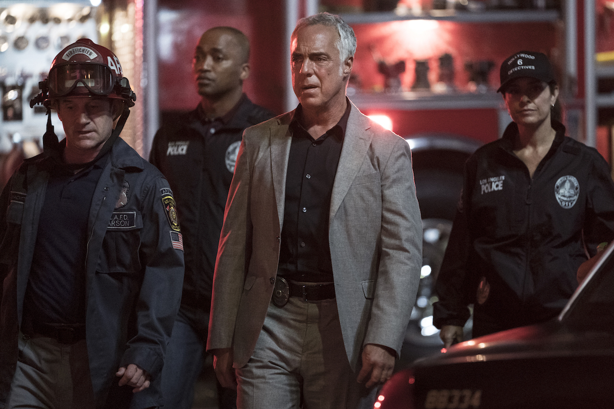 Harry Bosch surrounded by firefighters and paramedics in episode of Bosch Season 7