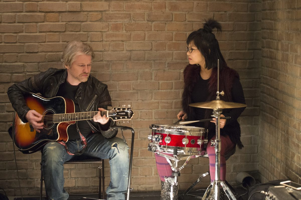 Todd Lowe plays guitar while Keiko Agena plays drums on 'Gilmore Girls- A Year in the Life'