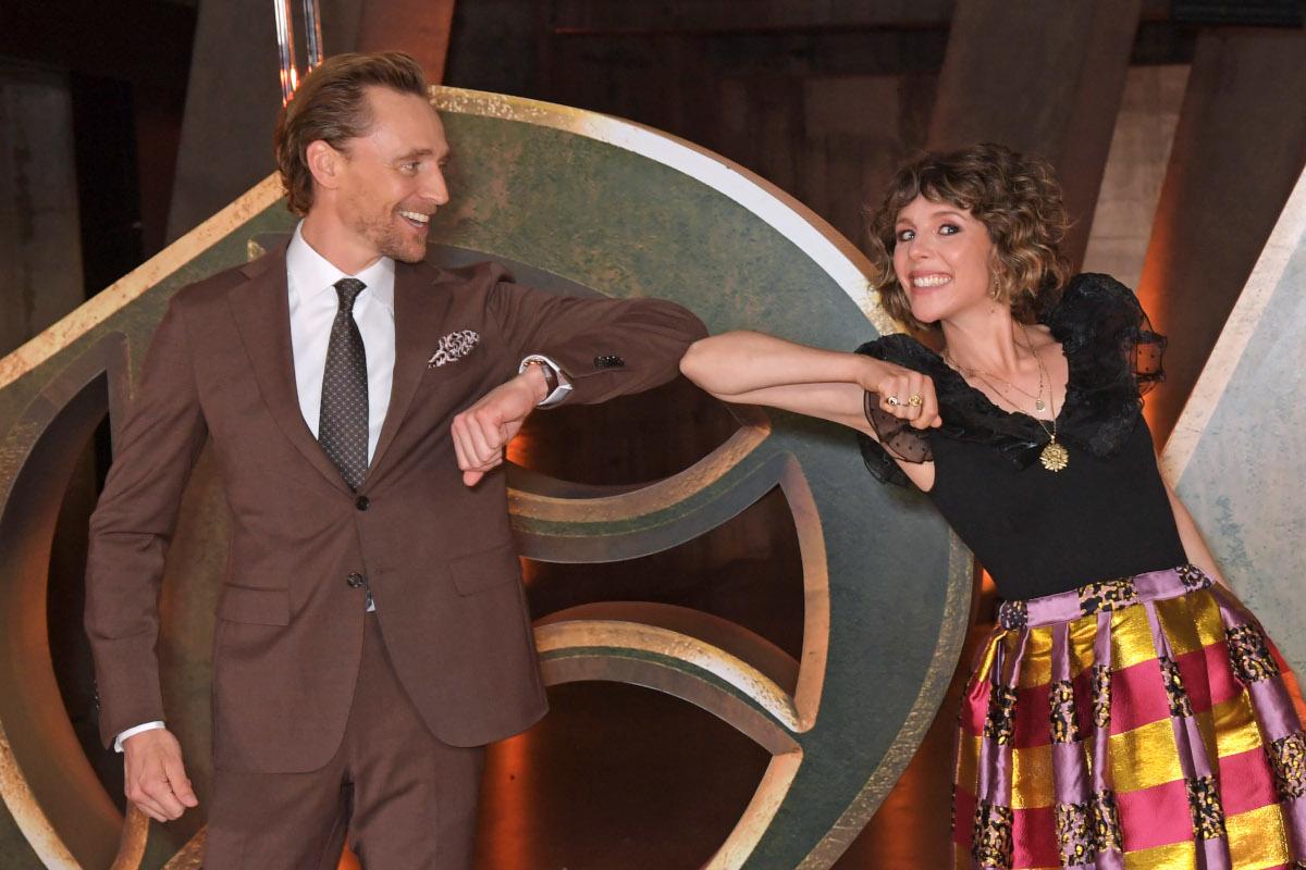 Tom Hiddleston and Sophia Di Martino bump elbows during screening of Loki