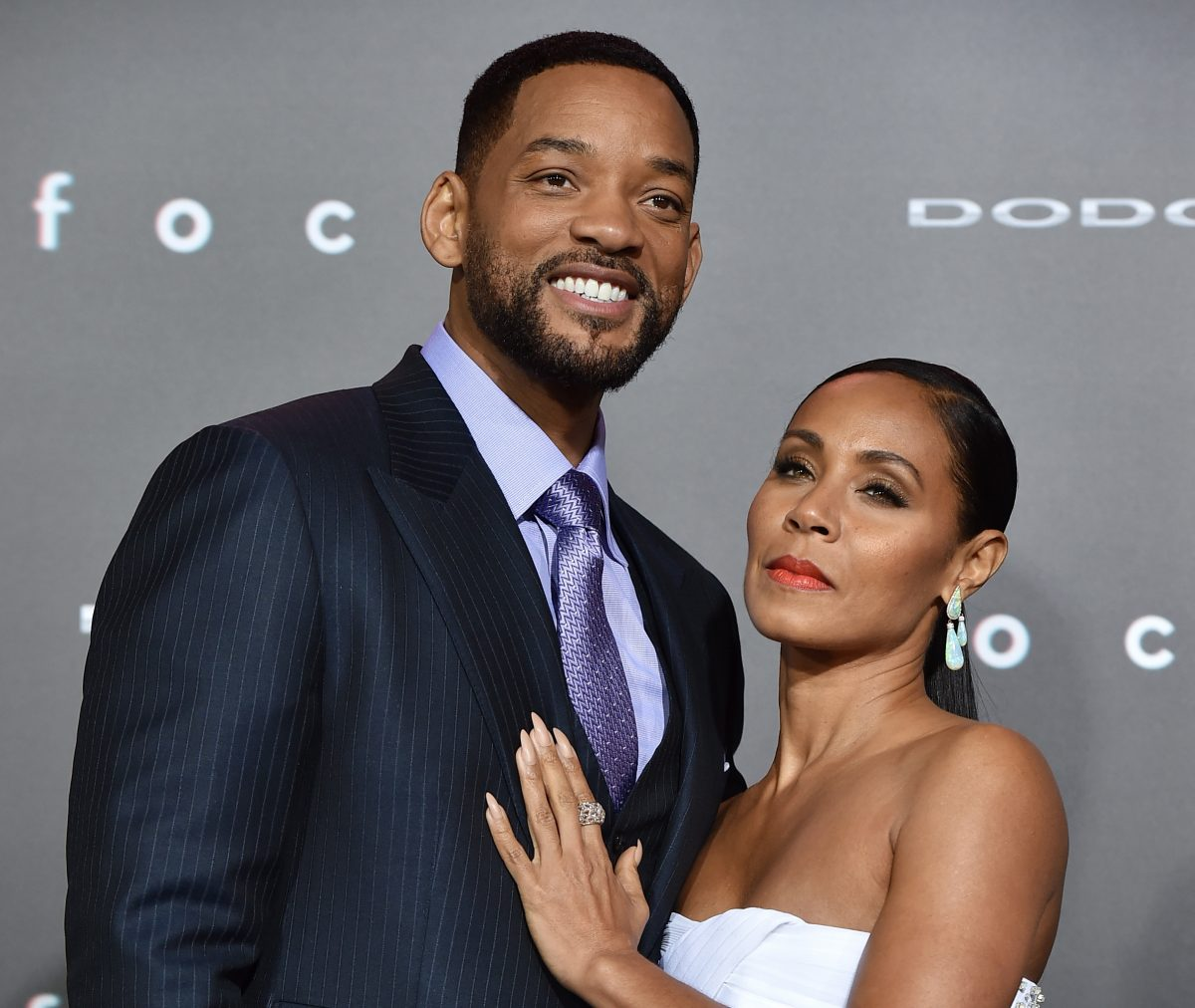 Will Smith and Jada Pinkett Smith posing at a film premiere in 2015.