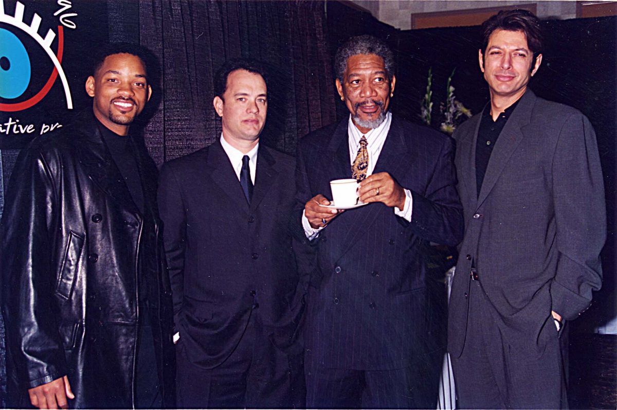 Will Smith, Tom Hanks, Morgan Freeman, and Jeff Goldblum, a few actors from 'Independence Day,' standing in suits together