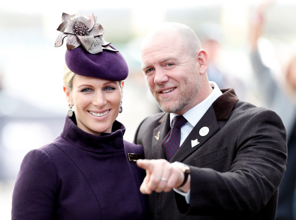 Zara Tindall smiling, Mike Tindall smiling and pointing