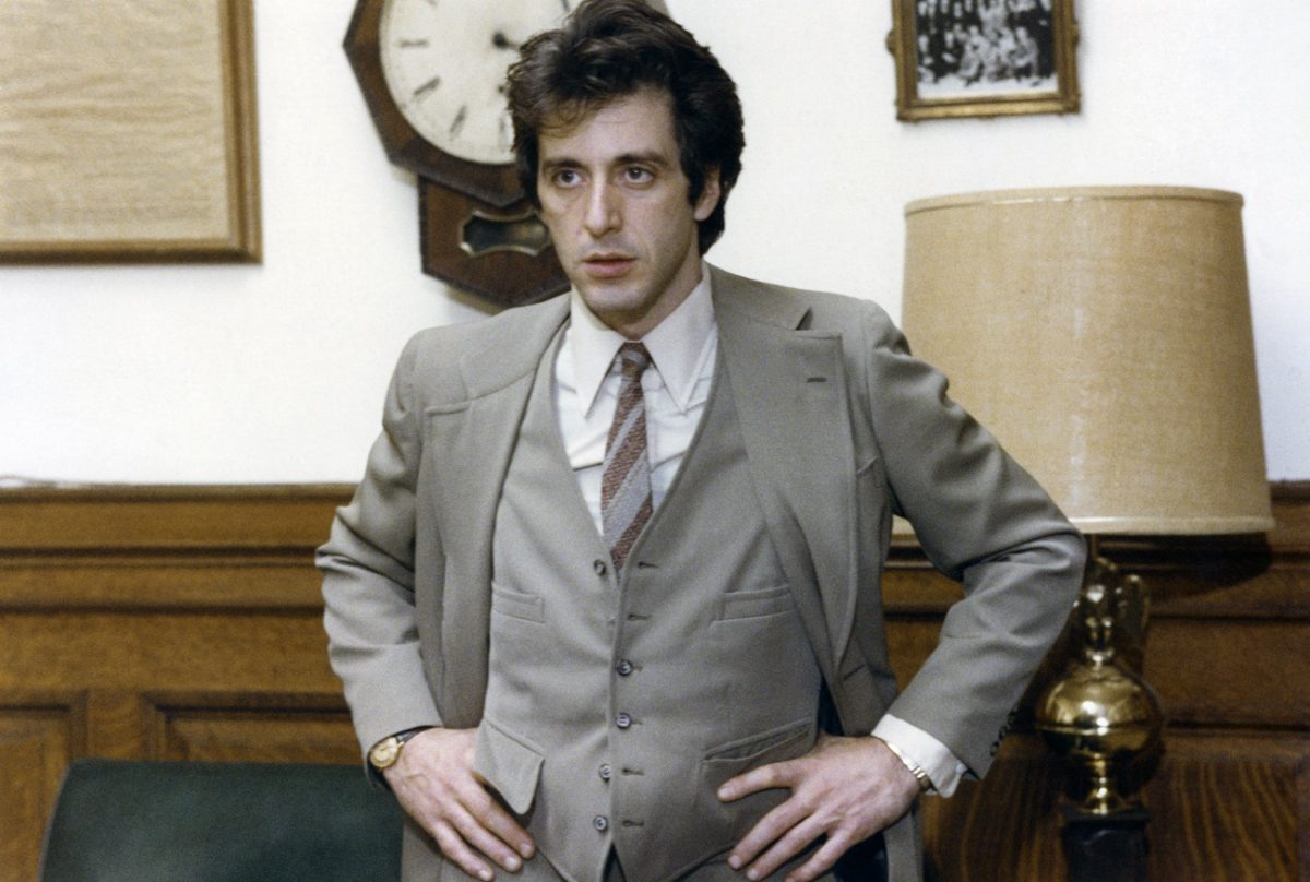 Al Pacino, playing an attorney, stands with his hands on his hips in 'And Justice for All.'