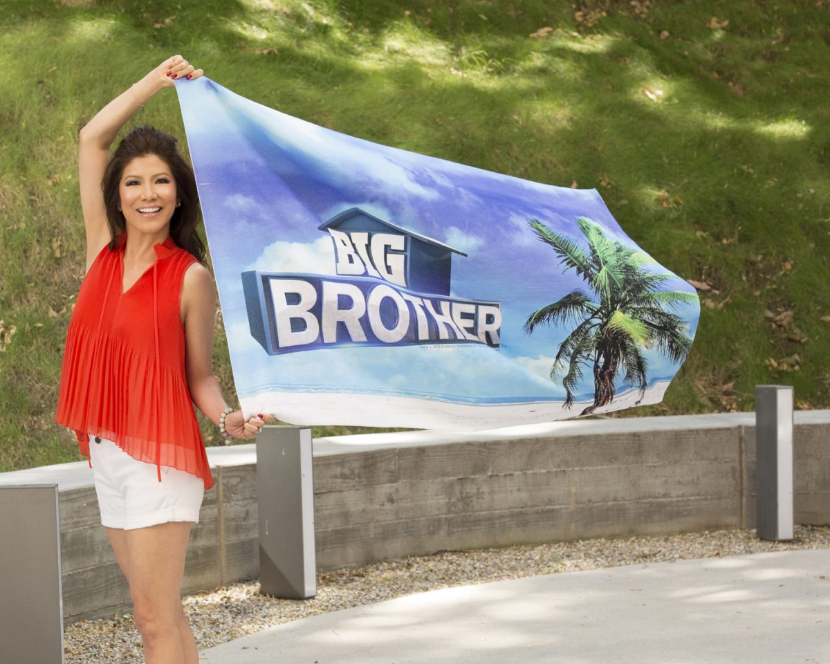 Julie Chen with a 'Big Brother' flag