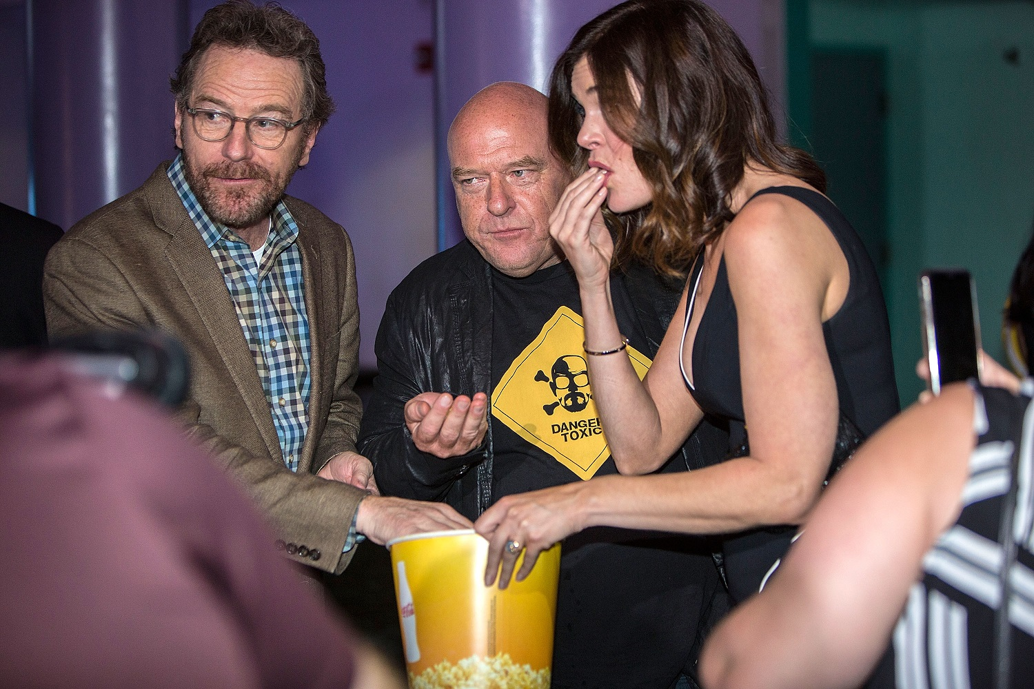 Breaking Bad stars Bryan Cranston, Dean Norris, and Betsy Brandt share a bucket of popcorn