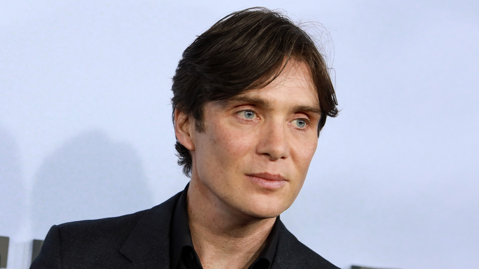 Actor Cillian Murphy poses for photographers.