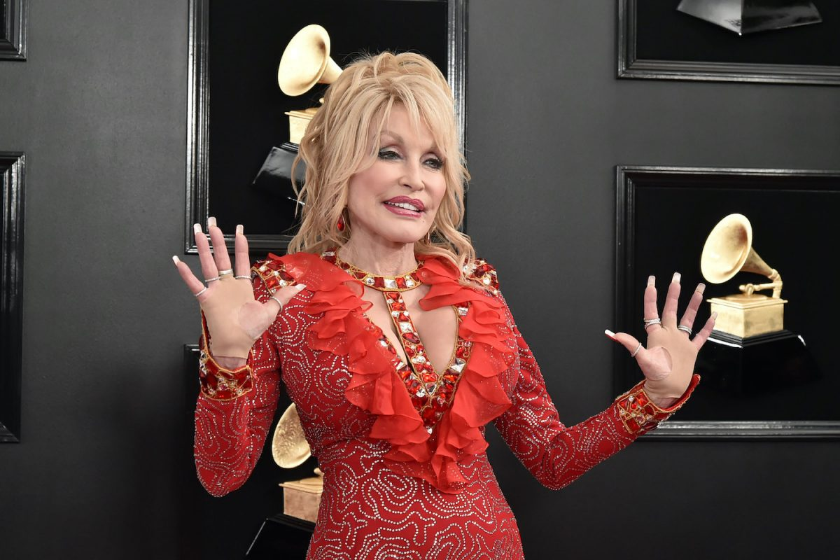 Dolly Parton wears a red low cut dress as she poses at the 61st Annual Grammy Awards at Staples Center on February 10, 2019