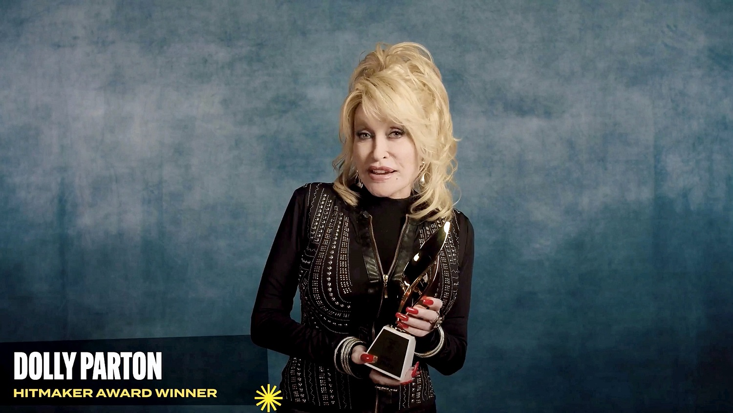Dolly Parton accepts the Hitmaker Award during the Billboard Women In Music 2020 event on December 10, 2020.