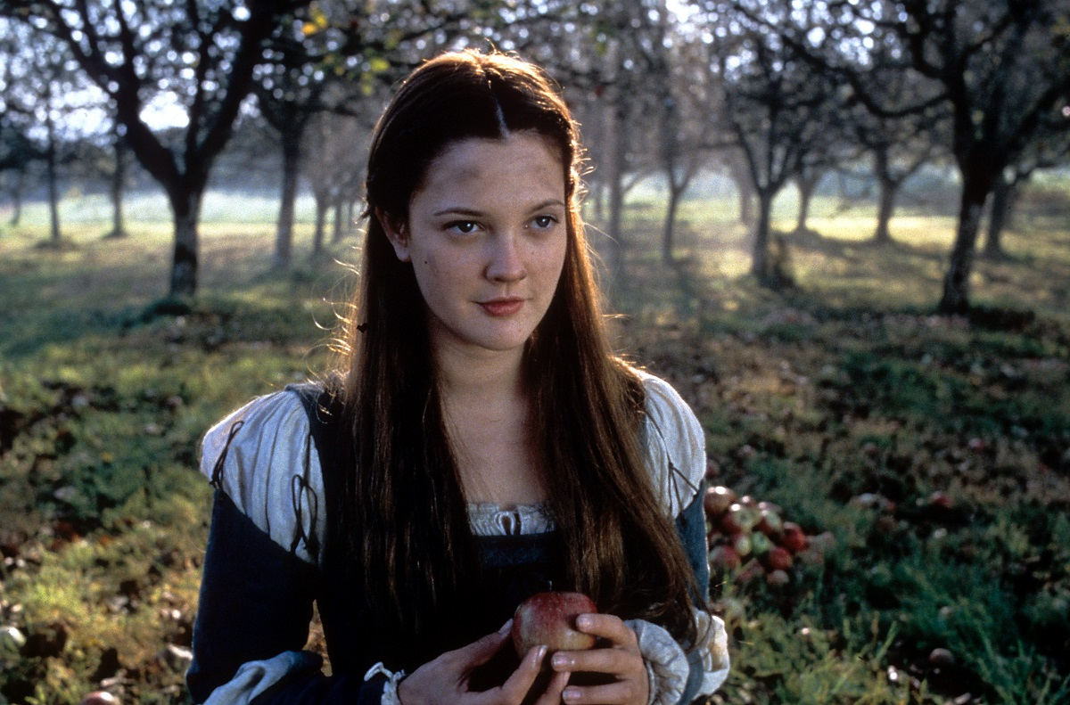 Drew Barrymore holding an apple in a scene from the film 'Ever After: A Cinderella Story,' 1998.