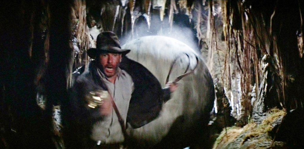 Harrison Ford as Indiana Jones running from a boulder in 'Raiders of the Lost Ark'