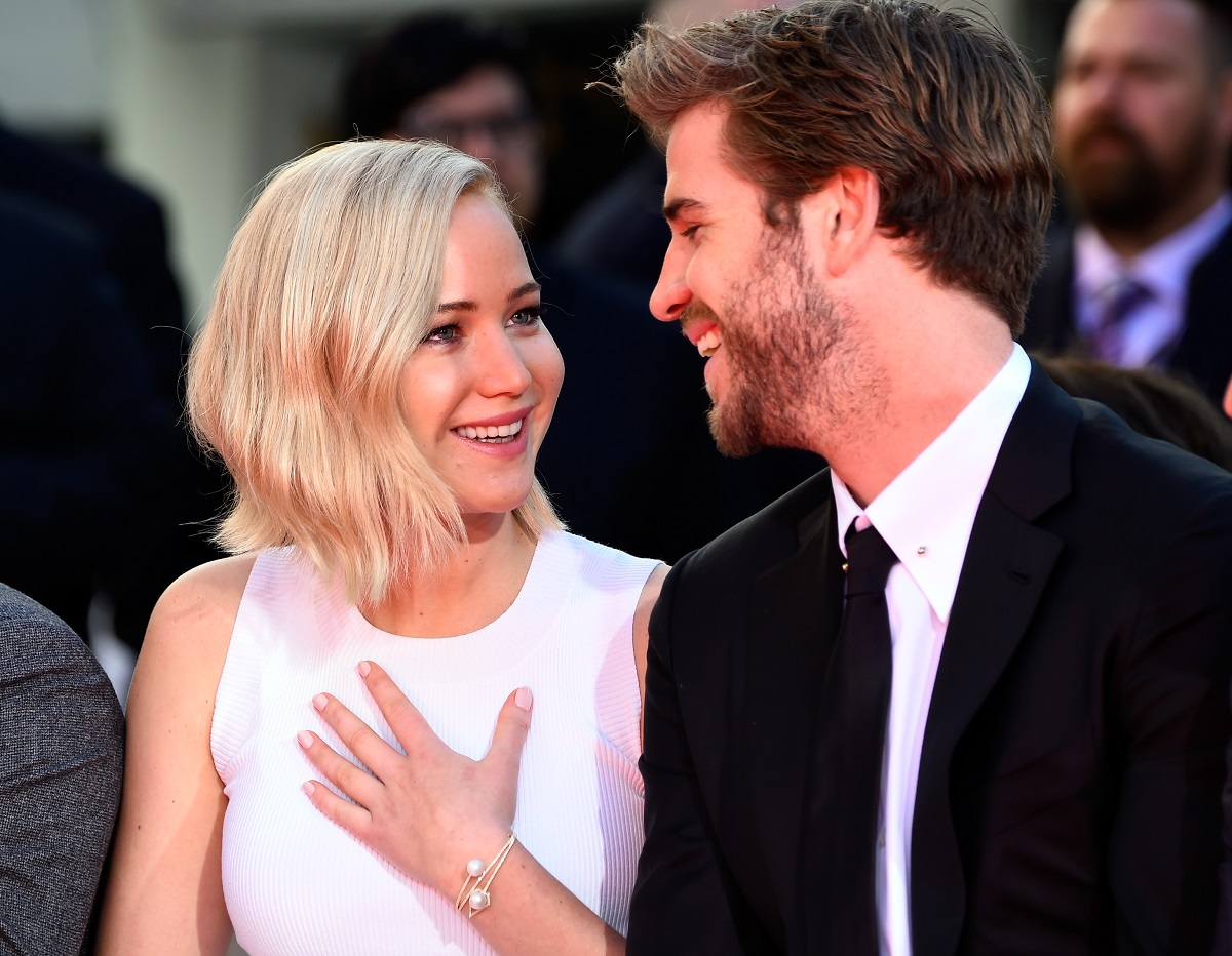 Jennifer Lawrence (L) and Liam Hemsworth on October 31, 2015 in Hollywood, California.