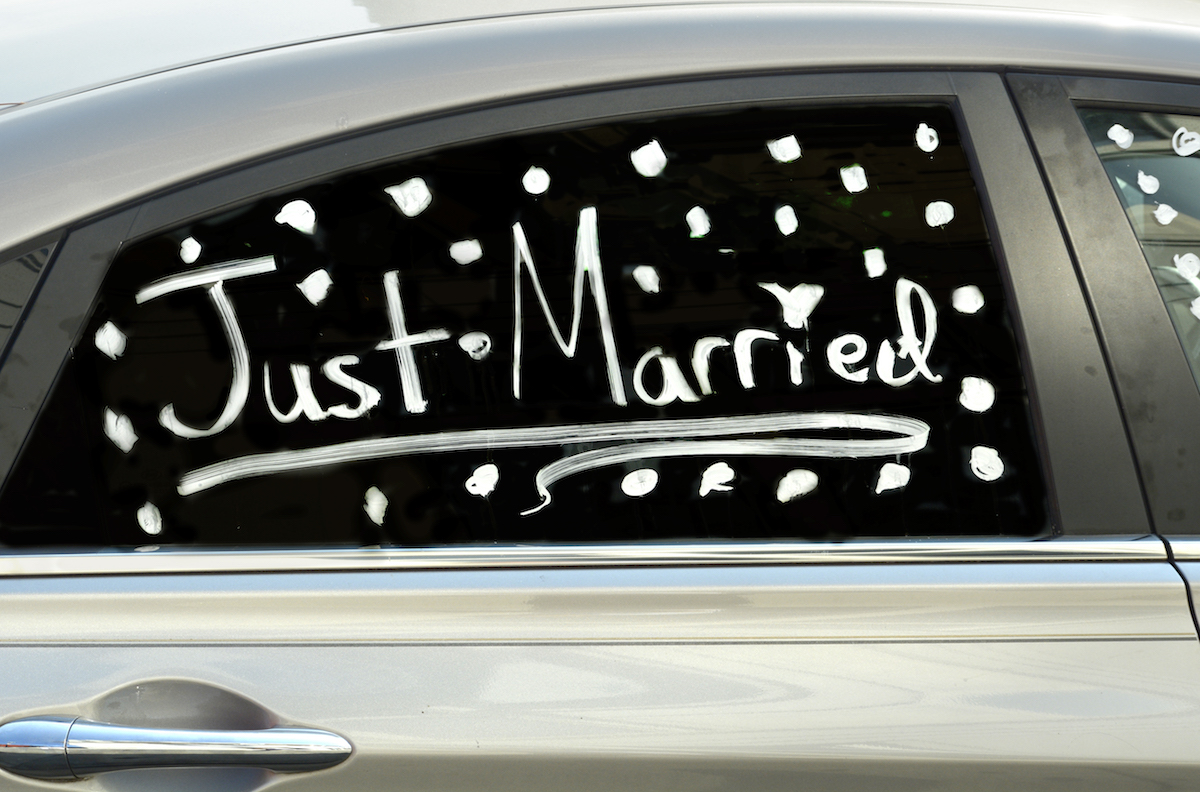 Just married written on the window of a car