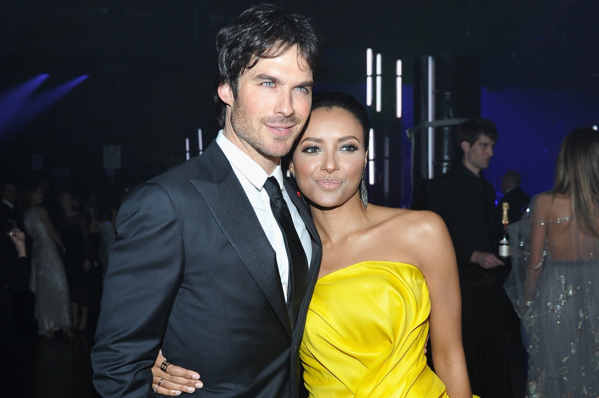 Ian Somerhalder in a suit and Kat Graham wearing a yellow dress