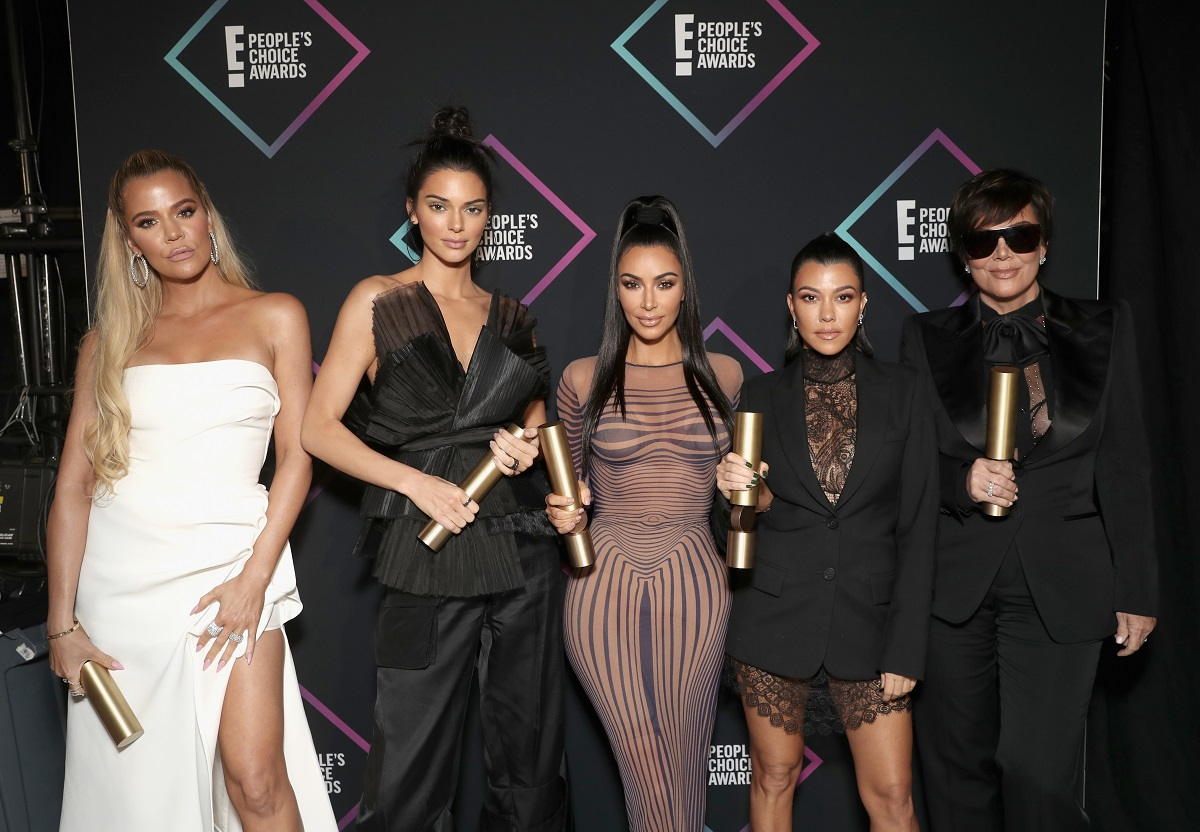 (L-R): Khloe Kardashian, Kendall Jenner, Kim Kardashian, Kourtney Kardashian, and Kris Jenner, winners of the Reality Show of 2018 for 'Keeping Up With the Kardashians' pose backstage during the 2018 E! People's Choice Awards