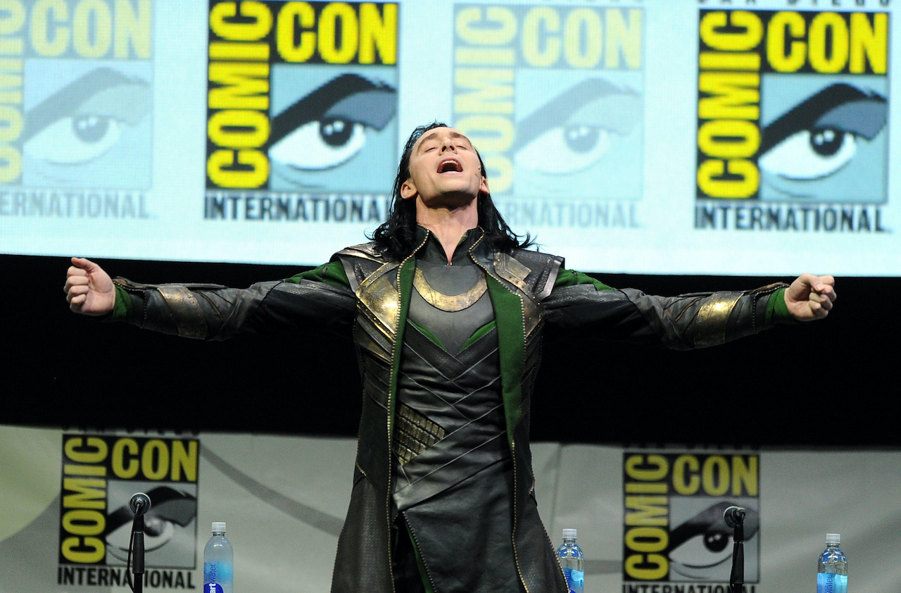 """Tom Hiddleston speaks onstage at Marvel Studios """"Thor: The Dark World"""" and """"Captain America: The Winter Soldier"""" during Comic-Con International 2013"""