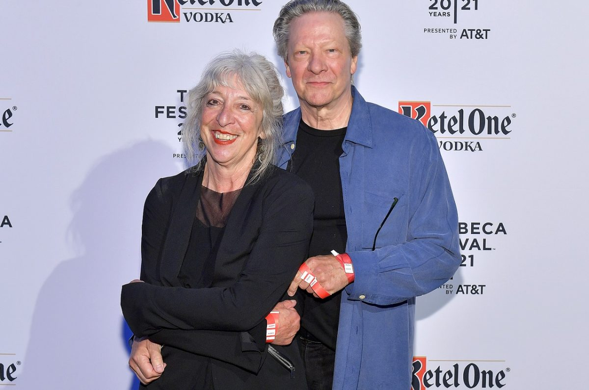 Marianne Leone and Chris Cooper hugging and smiling while posed for the camera at a 2021 Tribeca Festival event