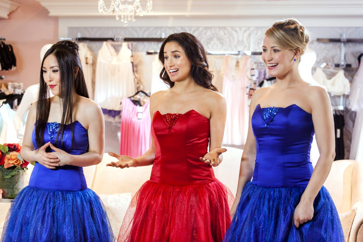 Meghan Markle wearing a strapless red dress in 'When Sparks Fly'