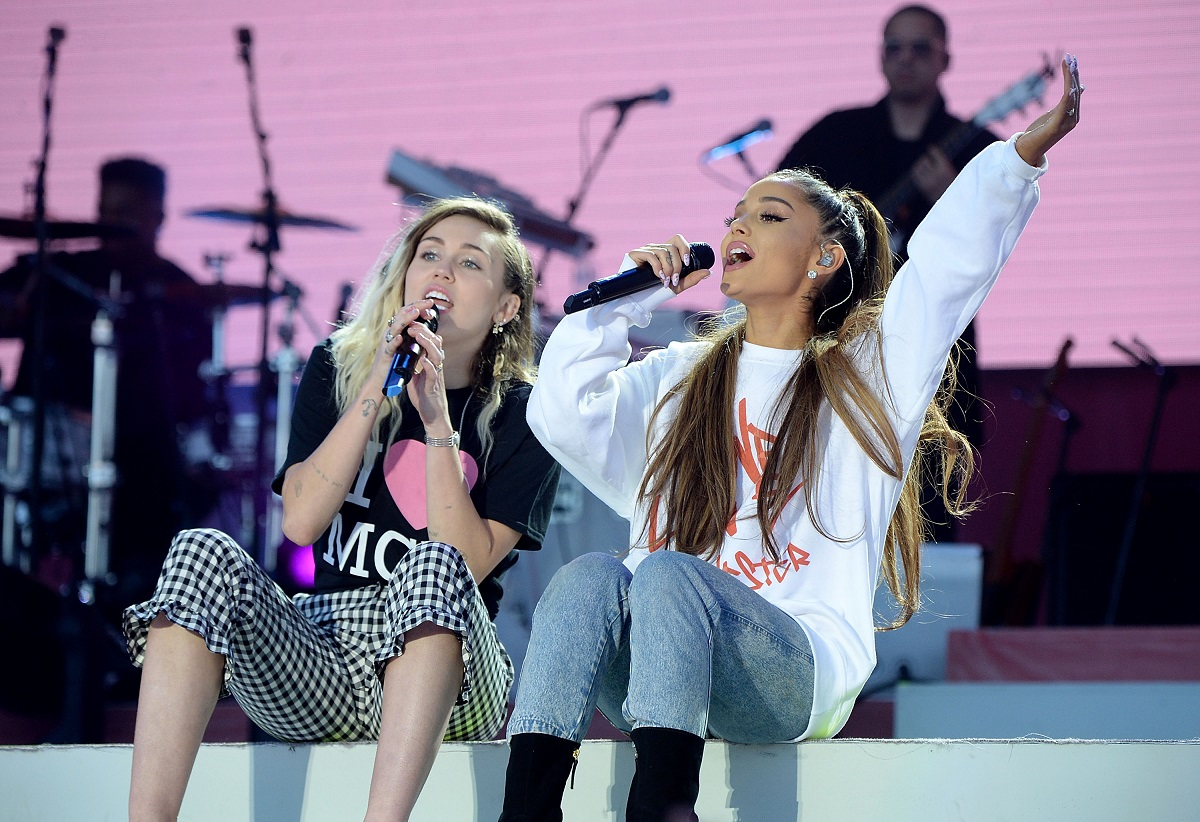 Ariana Grande (R) and Miley Cyrus perform on stage during the One Love Manchester Benefit Concert on June 4, 2017, in Manchester, England.