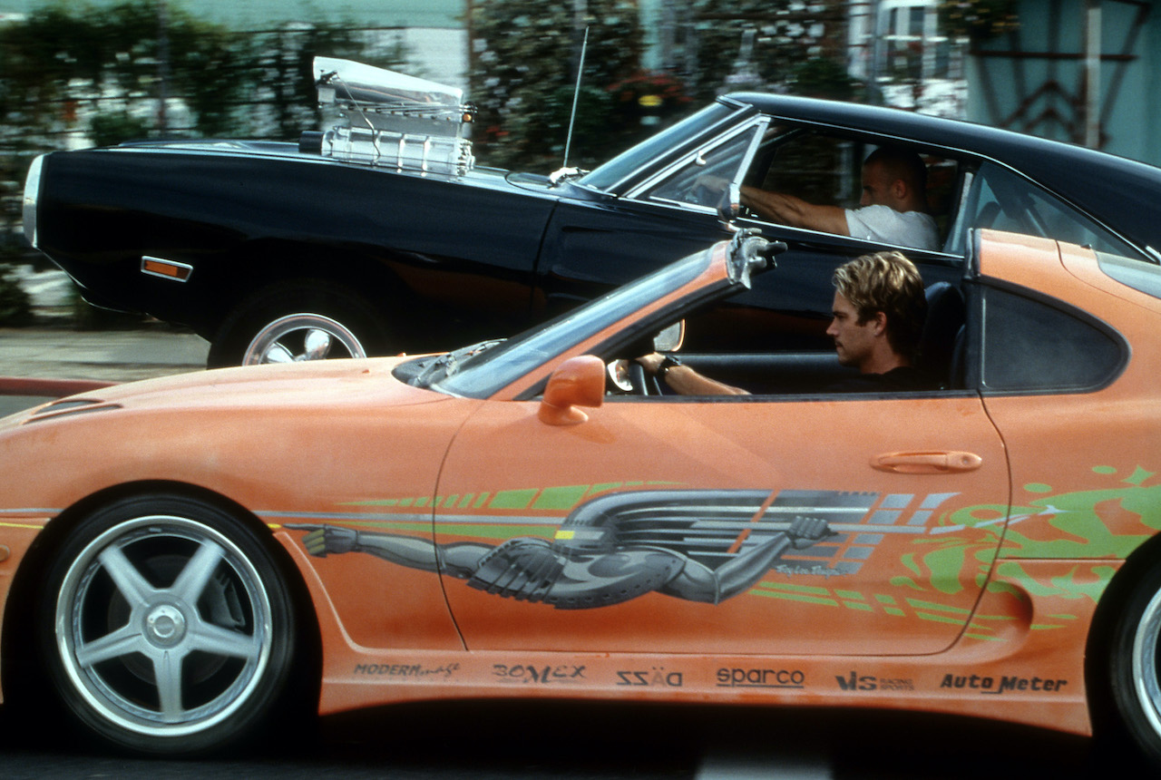 Vin Diesel and Paul Walker racing against each other in a scene from the film 'The Fast And The Furious'
