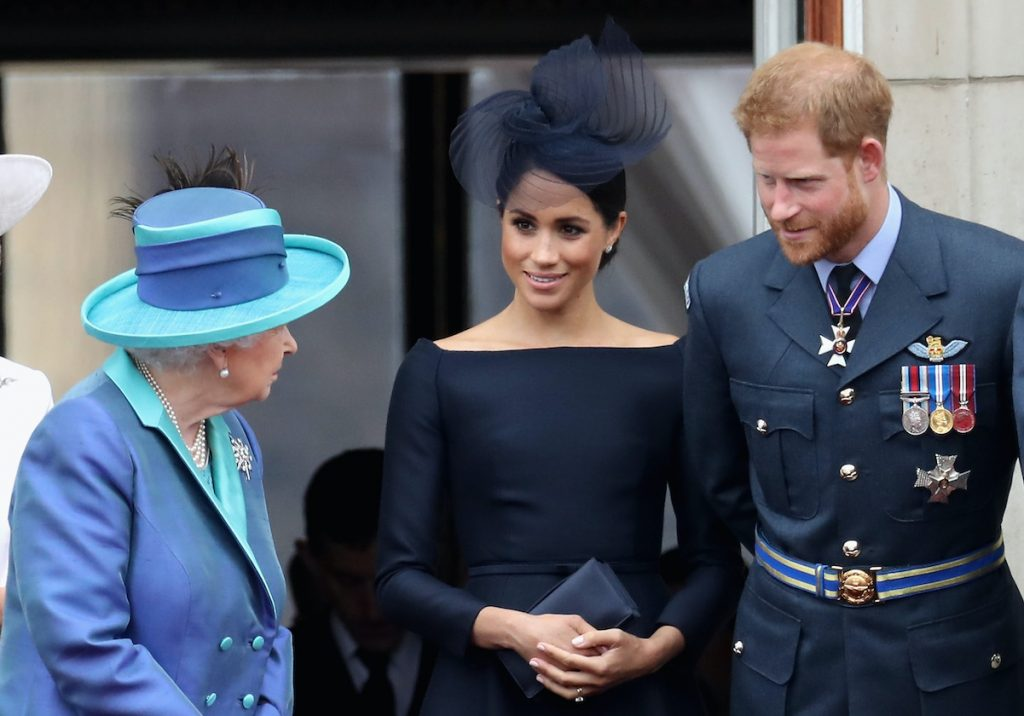 Queen Elizabeth, Prince Harry, and Meghan Markle have a conversation in 2018