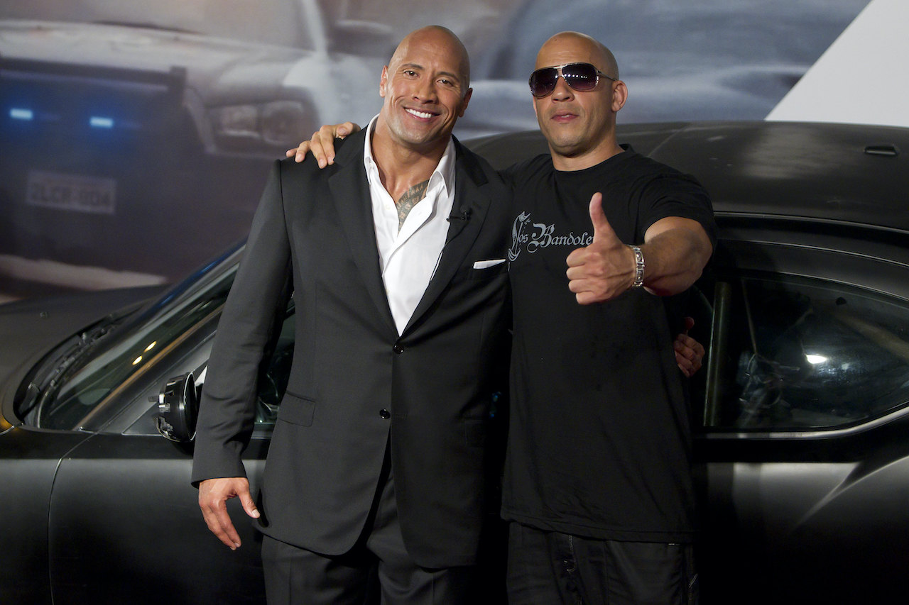 """Dwayne Johnson (The Rock) and Vin Diesel (R) pose for photographers during the premiere of the movie """"Fast and Furious 5"""""""
