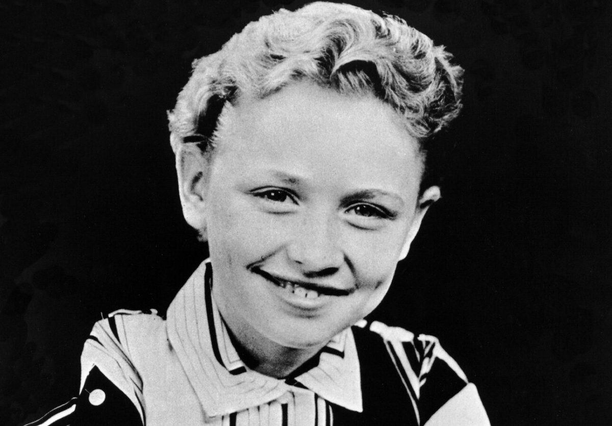 Dolly Parton photographed as a child in 1955 in black and white.