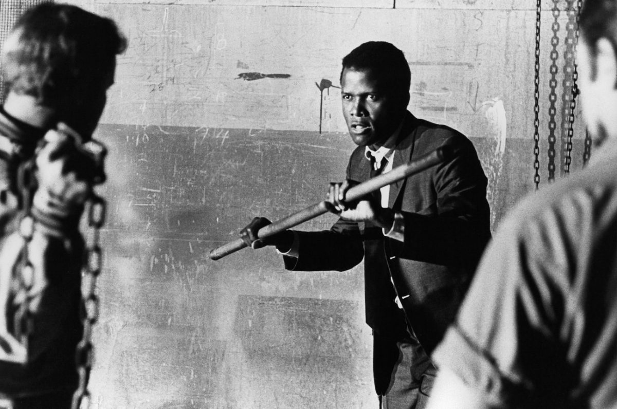Sidney Poitier fights off attackers with a metal pipe in a scene from 'IN the Heat of the Night.'