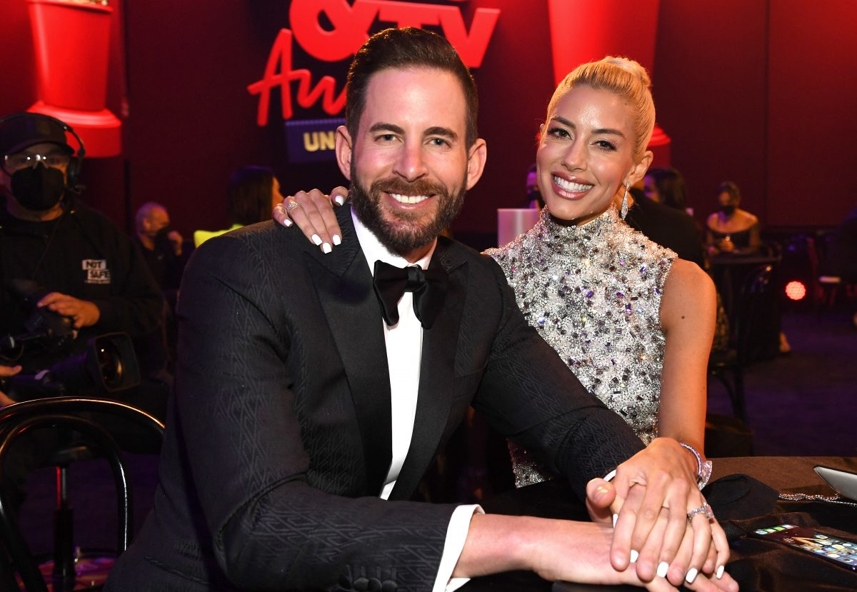 Tarek El Moussa and Heather Rae Young sitting at a table