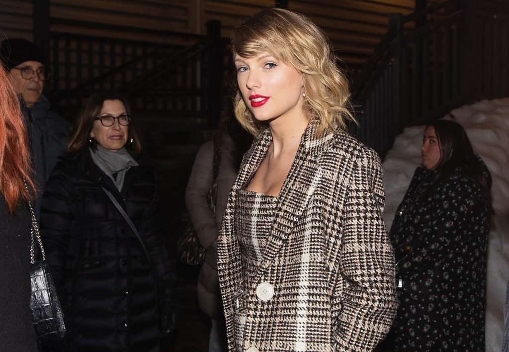 Taylor Swift in a black and white coat