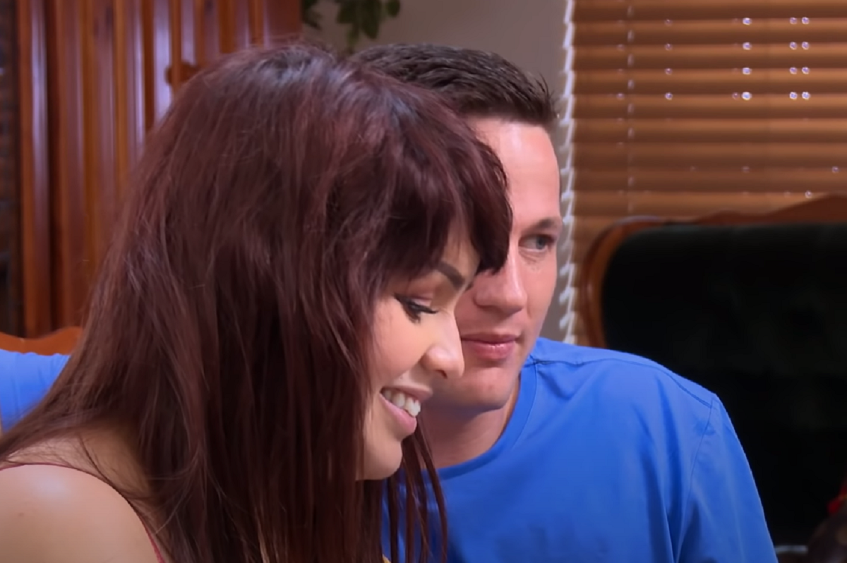 Tiffany and Ronald on 90 Day Fiancé smiling as they talk