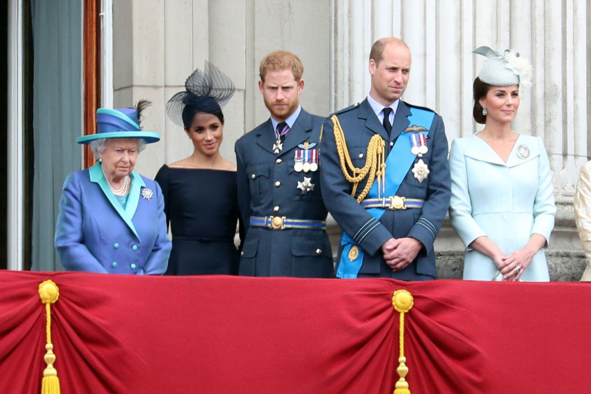 Queen Elizabeth II, Meghan Markle, Prince Harry, Prince William, and Kate Middleton stand on the balcony of Buckingham Palace