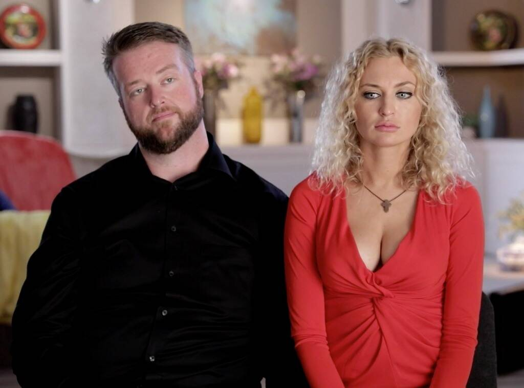 '90 Day Fiancé' couple Mike and Natalie sitting side by side and looking unhappy