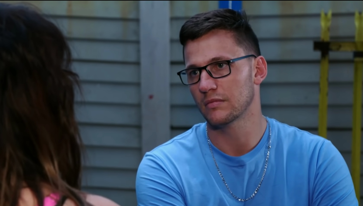 '90 Day Fiancé' couple Tiffany and Ronald. Ronald is wearing a blue shirt and glasses
