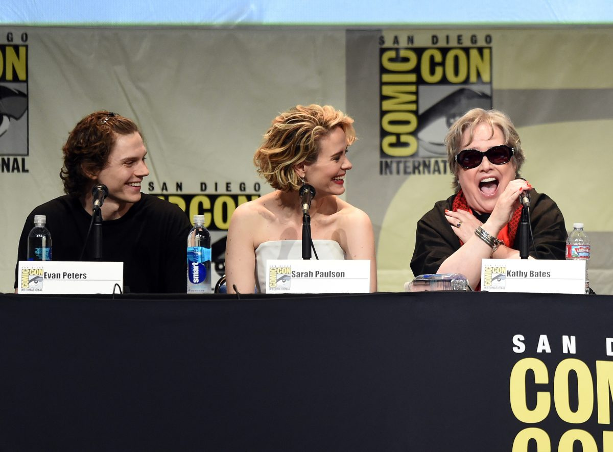 Evan Peters, Sarah Paulson, and Kathy Bates from 'American Horror Story' Season 10 sitting next to each other at a Comic Con panel in 2015