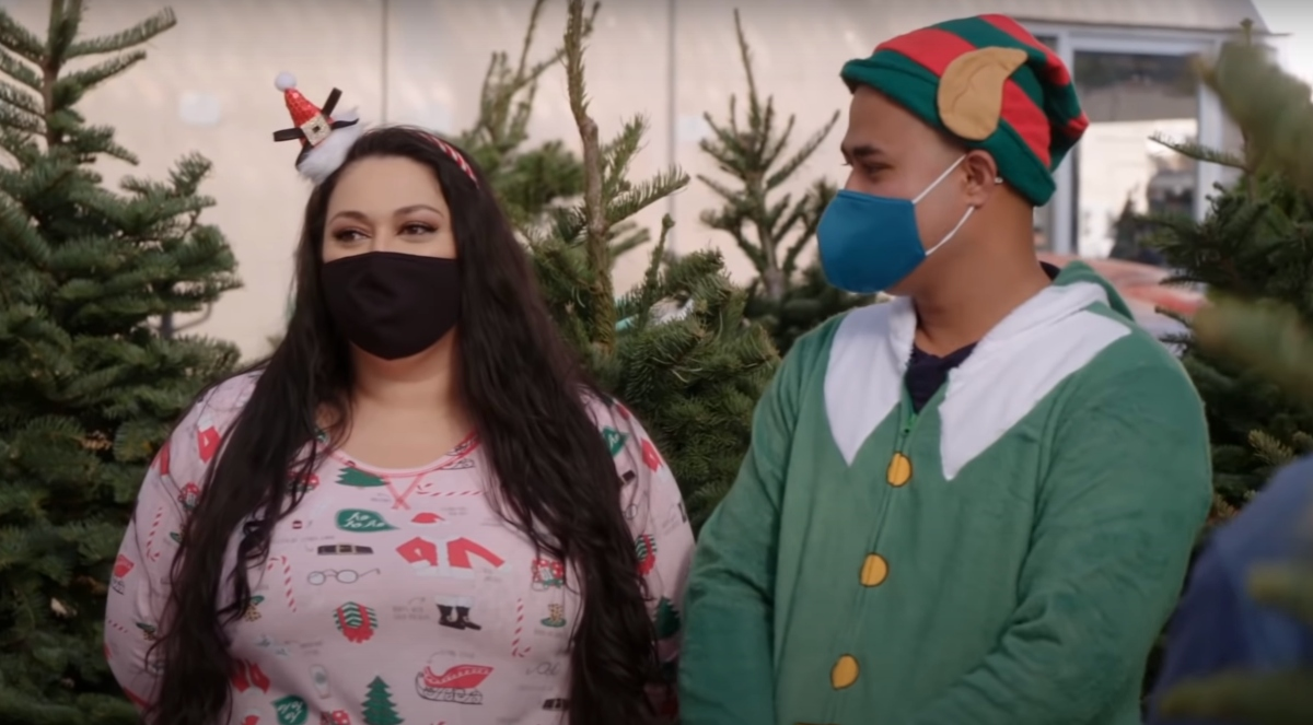 Asuelu Pulaa and Kalani Faagata wearing Christmas outfits on 90 Day Fiancé