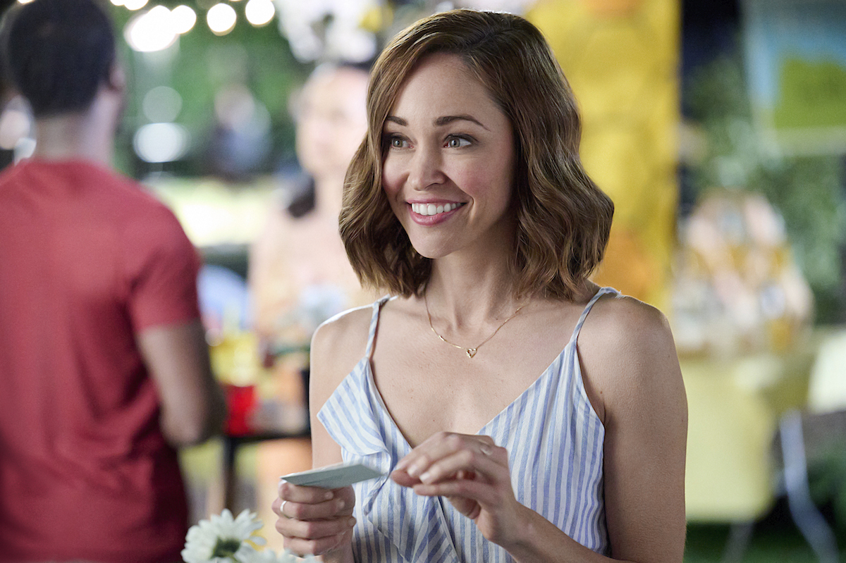 Autumn Reeser smiling in the Hallmark movie 'The 27-Hour Day'