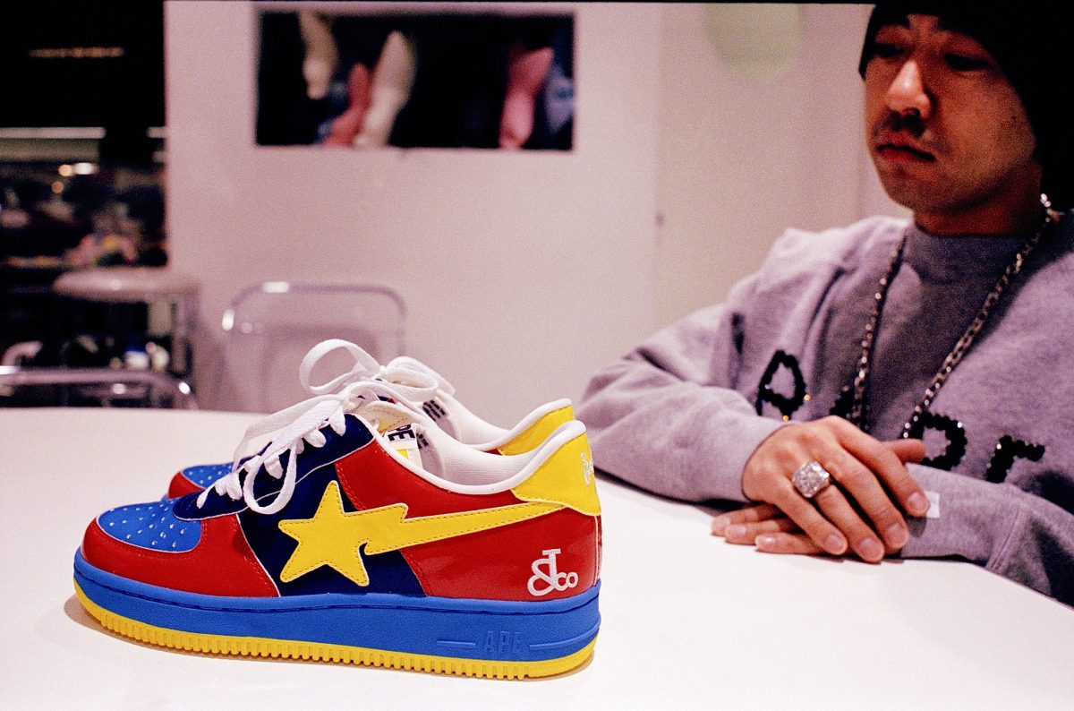 Nigo sits with a version of the Bapesta sneaker in 2004
